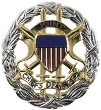 Joint Chiefs of Staff Breast Badge Mirrored Finish. Joint Chiefs of Staff Identification badge is worn by all branches of service.  It is awarded to military service members who serve a minimum tour of at least one year while working for the Joint Chiefs of staff.