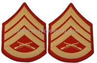 These gold embroidered on red chevrons are for the rank of Staff Sergeant(Male).Worn with the dress blue uniform.