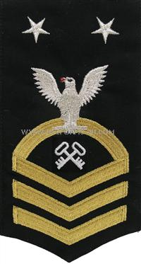 US Navy E9 Storekeeper Blue Rating Badge.Worn on the left sleeve of Dinner Dress Blue and the Navy Dress Blue uniform .All Rating Badges are made to military specifications.