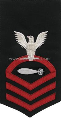 US Navy E7 Torpedoman&#39;s Mate Blue Rating Badge.Worn on the left sleeve of Dinner Dress blue and the Navy Dress Blue uniform .All Rating Badges are made to military specifications.